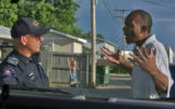 Aurora Police Lt. Bob Stef (cq) talks to unidentified man during patrol in the 1100 block alley of...