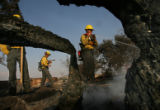 (from left) Tyler Chenoweth (cq), Paul Valdez (cq) and JT Cathcart (cq) form the Upper Pine Fire...