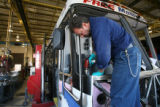 Mike DeHerrera, cq, RTD service mechanic, works on a defrost retrofit on one of RTD's 16th Street...