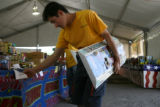 Guillerno Florez, cq, looks over the firework selection at the Olde Glory Fireworks stand Monday...