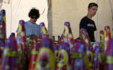 Matt Meyer, cq 16, and friend Kyle Crain,16, cq, (lt-rt) walk by the selection of fireworks at the...