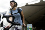 Christina Slichter(cq), of Denver, collects her bike at a tent behind Market Street Station on the...
