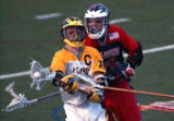 Denver, Colo., photo taken May 21, 2004- Arapahoe's Logan Bobzien (center yellow #1) is defended...