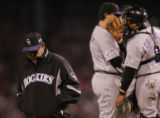 [RMN2420] Colorado Rockies pitching coach Bob Apodaca leaves the mound after talking with Ubaldo...