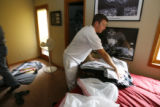 DM0415   Ryan Bird quickly packs up some of his stuff at his place at the Gold Run Condominiums...