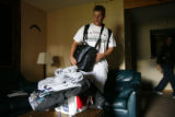 DM0427   Ryan Bird quickly packs up some of his stuff at his place at the Gold Run Condominiums...