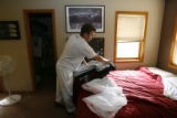 DM0411   Ryan Bird quickly packs up some of his stuff at his place at the Gold Run Condominiums...