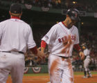 [RMN2241] Boston Red Sox Mike Lowell is congratulated after scoring on a sacrifice fly by Jason...