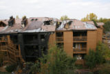 DM0413   The scorched remains of one of the buildings at the Gold Run condominium in Boulder,...