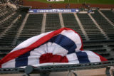 Bunting blows in the wind as the Rockies finish up batting practice, Coors Field, Friday evening,...