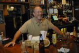 Reiver's Bar and Grille bar manager Doc Roberts (cq) laughs with customers during lunch hour in...