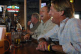 Long time Reiver's Bar and Grille customers Patrick Director (cq), second left) and Patrick Lyng...