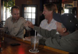 Long time Reiver's Bar and Grille customers Patrick Director (cq, left), Patrick Lyng (cq, middle,...