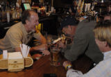 Reiver's Bar and Grille bar manager Doc Roberts (cq, left) laughs with Ritchie Strauss (cq,...