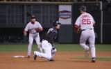 [1071]   Colorado Rockies Kaz Matsui is tagged out by Boston Red Sox third baseman Mike Lowell in...