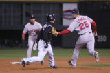 [1072]  Colorado Rockies Kaz Matsui is tagged out by Boston Red Sox third baseman Mike Lowell in a...