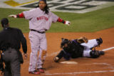 [1671]  Colorado Rockies catcher Yorvit Torrealba holds the ball out to home plate umpire Ted...