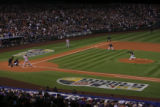 [458]  Colorado Rockies pitcher Josh Fogg delivers the first pitch to Boston Red Sox leadoff...