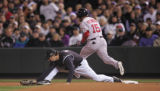 [839]  Colorado Rockies first baseman Todd Helton stretches but Boston Red Sox Dustin Pedroia...