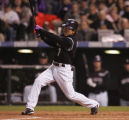 [879]  Colorado Rockies Kaz Matsui hits a single, the first Rockies hit of the World Series at...