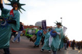 Employees of Liberty Tax services dress themselves as the statue of Liberty to promote their...
