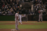 [641} Colorado Rockies starting pitcher Josh Fogg, walks back to the mound as Boston Red Sox, Mike...