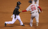 [857} Colorado Rockies , Kazuo Matsui, is tagged out between second and third by Boston Red Sox,...