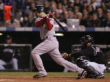 [1760]  Boston Red Sox batter Mike Lowell singles to drive in two runners in the third inning of...