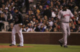 [1770]  Colorado Rockies Josh Fogg walks back to the mound after Boston Red Sox David Ortiz,...
