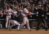 [1799]  Home plate umpire Ted Barrett calls out Boston Red Sox Manny Ramirez after Colorado...