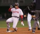 [1823]  Boston Red Sox Julio Lugo slides into second base safely after hitting a double in the...