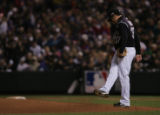 [1753]  Colorado Rockies Josh Fogg kicks dirt on the mound after giving up a run on a double by...