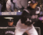 [3733]  Colorado Rockies manager Clint Hurdle watches Kaz Matsui at the plate in the eighth inning...