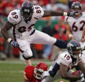 [EPS101] Denver Broncos tight end Daniel Graham, top, leaps over wide receiver Brandon Marshall,...