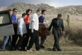 Pall bearers carry the casket of  David Rance Rossiter  at the Sheridan Cemetery in Sheridan, ...
