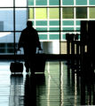 An airline passenger walks to the ticketing area before entering  security screening after at...