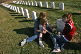 DM0766  a Tracey Murphy and her daughters Morgan, 5, and Ashley, 13, visit the grave of Tracey's...