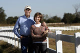 Joel and Lynn Hefley pose for a picture at their 80-acre in Blanchard, Okla., Friday, October 26,...