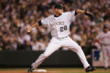 [4793]  Colorado Rockies pitcher Aaron Cook delivers the first pitch in the first inning of Game 4...