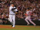 [4552]  Colorado Rockies Garrett Atkins throws out Boston Red Sox Dustin Pedroia as baserunner...