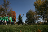 Members of the Save Darfur Coalition march with a torch as part of a rally in Cheeseman Park in...