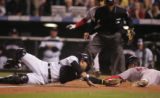 [5473]  Colorado Rockies catcher Yorvit Torrealba tries to tag out Boston Red Sox runner Mike...