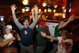 "DM1258   Boston fans cheer at The Elm, one of Denver's ""Red Sox"" bars  after the Red Sox..."