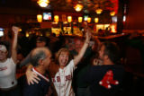 "DM1260   Boston fans Wayne and Rena Lumbert cheer at The Elm, one of Denver's ""Red Sox""..."