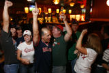 "DM1271   Boston fans cheer at The Elm, one of Denver's ""Red Sox"" bars  after the Red Sox..."