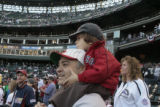 [121} Boston red Sox fans Charlie Slotnik Zachary Slonnik, 3, take in the pre game excitement of...