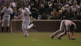 [732} Colorado Rockies, Aaron Cook, sprints for 1st base as the ball skips past Boston Red Sox...