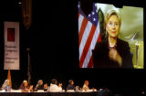 Members of the National Congress of American Indians applaud at Senator Hillary Clinton after she...