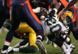 #80 Donald Driver is wrapped up in the 1st after a receptionas the Broncos host the Green Bay...