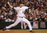 [4853]  Colorado Rockies pitcher Aaron Cooks delivers a pitch in the second inning of Game 4 of...